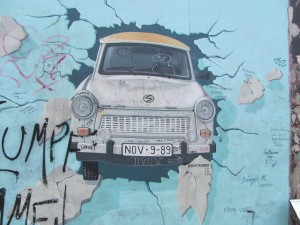 2015: Painting on a piece of the Wall showing a car breaking through to freedom.
