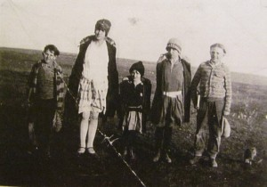 My dad (far right, age 10) heads to the country school with his brother and sisters.